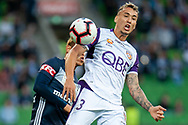 Perth Glory defender Jason Davidson (3) winning the header at the Hyundai A-League Round 2 soccer match between Melbourne Victory and Perth Glory at AAMI Park in Melbourne.