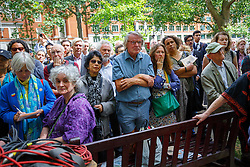 © London News Pictures. 06/08/2015. London, UK. People listening Labour Party leader candidate Jeremy Corbyn at a Campaign for Nuclear Disarmament rally to mark the 70th Anniversary of the atomic bombings of Hiroshima and Nagasaki in Tavistock Square, London on Thursday, August 6, 2015. Photo credit: Tolga Akmen /LNP