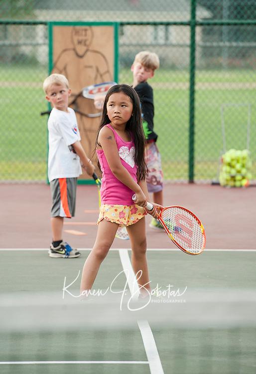 Tennis lessons at Memorial Park in Laconia.  (Karen Bobotas Photographer)