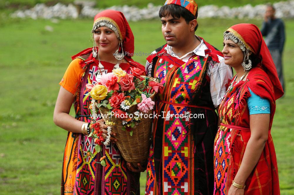 India, Vashisht near Manali, Kullu District, Himachal Pradesh, Northern India, locals in traditional dress, selling flowers