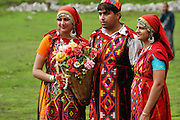 India, Vashisht near Manali, Kullu District, Himachal Pradesh, Northern India, locals in traditional dress, selling flowers