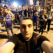 TURKPIX photographers Aykut AKICI seen. Turkish Superleague soccer teams Besiktas, Fenerbahce and Galatasaray supporters, met today in Taksim Square. A harsh police crackdown on a small campaign to save an Istanbul park on May 31 triggered nationwide protests against Erdogan. Photo by AYKUT AKICI/TURKPIX