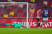 Football - 2020 /2021 Emirates FA Cup - Third Round: Brentford vs. Middlesbrough <br />  -  Brentford Community Stadium<br /> <br /> Luke Daniels (Brentford  FC) dives towards his post to prevent the goal <br /> <br /> COLORSPORT/DANIEL BEARHAM