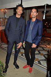PICTURE SHOWS:-Left to right, CHARLIE CASELY-HAYFORD and HUGO TAYLOR.<br /> Tuesday 14th April 2015 saw a host of London influencers and VIP faces gather together to celebrate the launch of The Ivy Chelsea Garden. Live entertainment was provided by jazz-trio The Blind Tigers, whilst guests enjoyed Moët & Chandon Champagne, alongside a series of delicious canapés created by the restaurant's Executive Chef, Sean Burbidge.<br /> The evening showcased The Ivy Chelsea Garden to two hundred VIPs and Chelsea<br /> residents, inviting guests to preview the restaurant and gardens which marry<br /> approachable sophistication and familiar luxury with an underlying feeling of glamour and theatre. The Ivy Chelsea Garden's interiors have been designed by Martin Brudnizki Design Studio, and cleverly combine vintage with luxury, resulting in a space that is both alluring and down-to-earth.