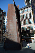 Fulcrum by American sculptor Richard Serra at Liverpool Street Station in London, UK. Richard Serra is an American minimalist sculptor and artist known for working with large-scale assemblies of sheet metal. Serra was involved in the Process Art Movement.