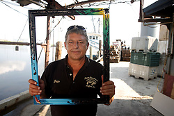 01 June 2010. New Orleans, Louisiana, USA.  <br /> Dean Blanchard of Dean Blanchard Seafood Inc shot on set in Chalmette for Spike Lee's latest movie, 'If God is Willing and da Creek Don't Rise.'<br /> Photo ©; Charlie Varley.