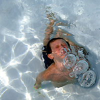 (PPAGE1) SEA BRIGHT 7/29/2003  Liam McCabe 10 of Middletown blows bubble as he surfaces from the pool at the Ship Ahoy Beach Club in Sea Bright.  Michael J. Treola Staff Photographer....MJT