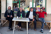 A group of men sitting and talking in front of the local grocery store in the city of Crnik. Crnik has almost 90% of unemployment.