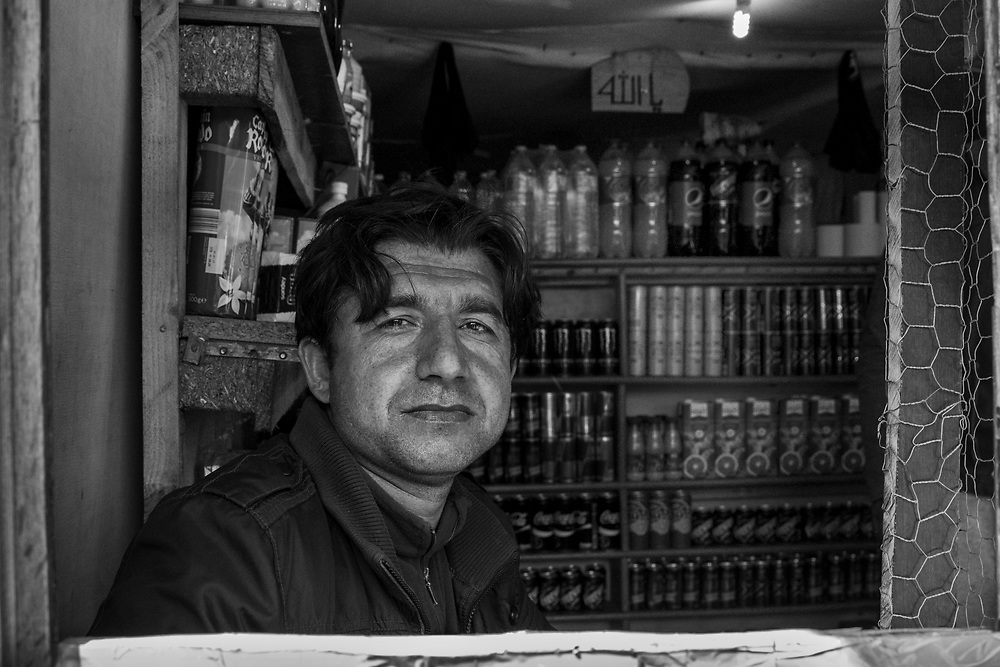 Shopkeeper. The shops and restaurants were a lifeline for the 10,000 inhabitants of the Calais Jungle.