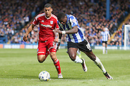 Sheffield Wednesday striker Lucas Joao (18) takes on Cardiff City defender, Lee Peltier (2) during the Sky Bet Championship match between Sheffield Wednesday and Cardiff City at Hillsborough, Sheffield, England on 30 April 2016. Photo by Ellie Hoad.