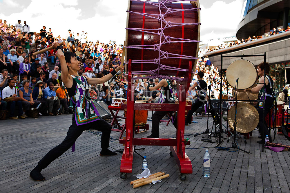 Joji Hirota's†Taiko Drummers†from Japan performing in the Scoop during the Thames Festival which celebrates London and the iconic river at its heart - the Thames - by dancing in the streets, feasting on bridges, racing on the river and playing at the water's edge..