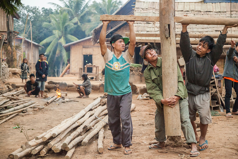 Men adjust the position of the stilts for a new house being built in Ban Pak Luang, Laos. The raised stilts help protect from mud and floods common during the rainy season. The village would only suffer minor inundation by proposed Dam #3 (whose construction has not yet commenced).