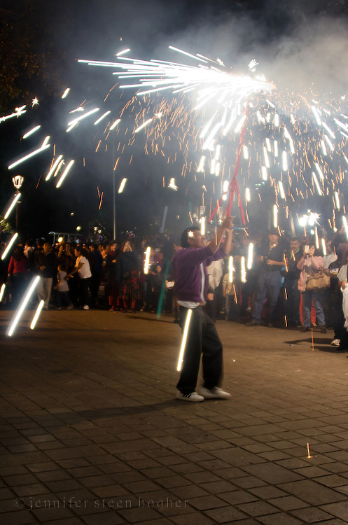 A Catherine Wheel firework spins and flings sparks over spectators of a Christmas Eve posada in Oaxaca, Mexico.