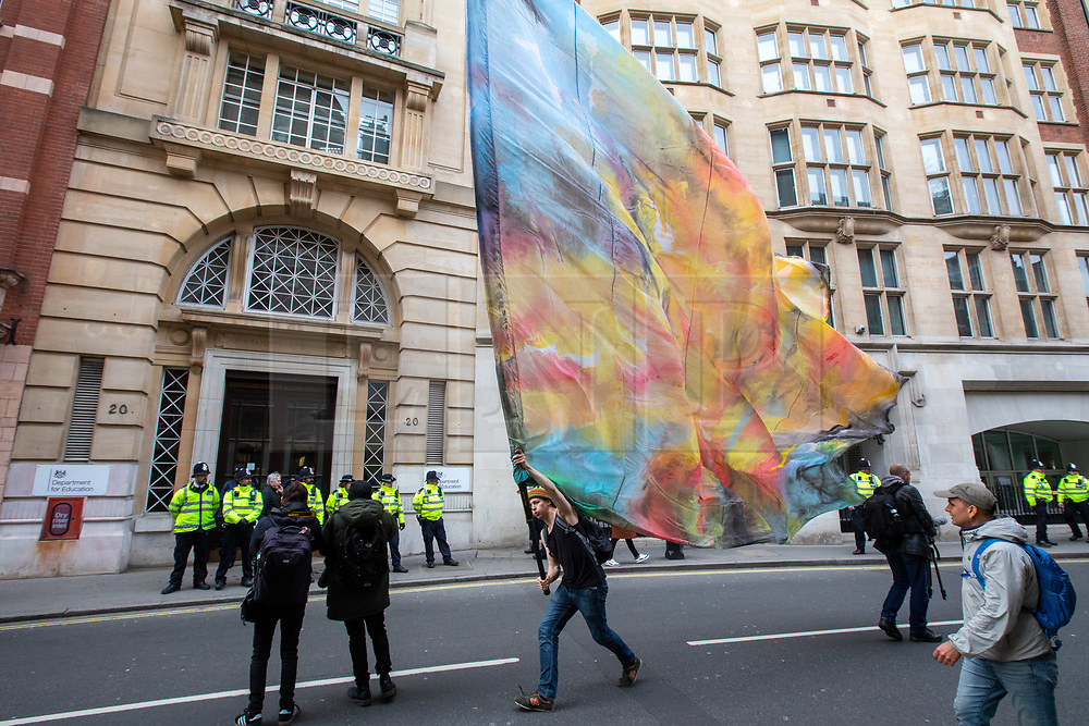 © Licensed to London News Pictures. 14/02/2020. London, UK. Police and flag waver outside the Department of Education as Students climate change strikers demonstrate on the streets of Westminster to protest against the Governments's lack of action on the climate crisis. Photo credit: Alex Lentati/LNP