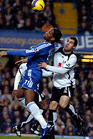 Photo: Ed Godden.<br />Chelsea v Fulham. The Barclays Premiership. 30/12/2006.<br />Chelsea's Didier Drogba (L), is challenged in the air by Carlos Bocanegra.
