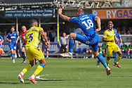 AFC Wimbledon striker James Hanson (18) controlling the ball during the EFL Sky Bet League 1 match between AFC Wimbledon and Bristol Rovers at the Cherry Red Records Stadium, Kingston, England on 19 April 2019.