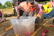 A competitor during dunking for pigs feet contest at the 2015 National Red Neck Championships May 2, 2015 in Augusta, Georgia. Hundreds of people joined in a day of country sport and activities.