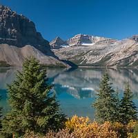 Crowfoot Mountain, Portal Peak & Mount Thompson (LtoR) reflect in Bow Lake in Banff National Park, Alberta, Canada.