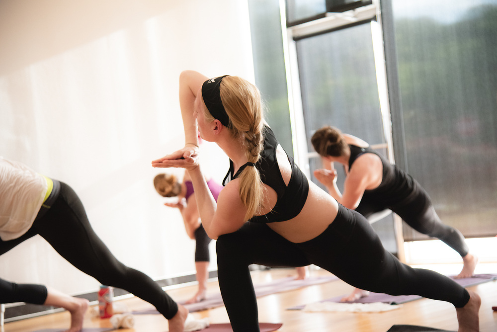 Yoga class at Clubhaus Fitness in Little Rock, Arkansas. Image created by commercial photographer, Alex Kent