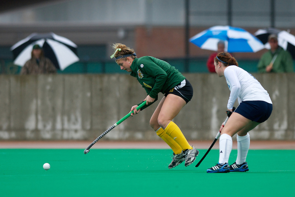 Catamounts midfielder Callie Bellimer (11) hits the ball during the women's field hockey game between the Maine Black Bears and the Vermont Catamounts at Moulton/Winder Field on Saturday afternoon September 29, 2012 in Burlington, Vermont.