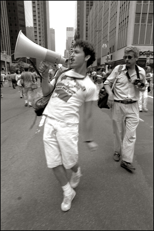 """Ron Goldberg of ACT UP NY, on June 24, 1989, the 20th anniversary of the Stonewall riots, participating in a renegade march up 6th avenue to Central Park. Themed, """"In The Tradition"""", this march followed the same route as the original march 20 years ago and was designed as a rebuke to the corporatization of the gay pride parade."""