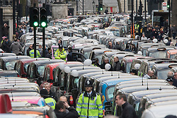 Whitehall, London, February 10th 2016. Taxis stopped on Whitehall as an estimated 8,000 cabbies hold a go-slow in protest against what they say is unfair competition from minicab and Uber drivers who do not have to undergo the rigorous training and checks required for the licenced taxi trade. ///FOR LICENCING CONTACT: paul@pauldaveycreative.co.uk TEL:+44 (0) 7966 016 296 or +44 (0) 20 8969 6875. ©2015 Paul R Davey. All rights reserved.