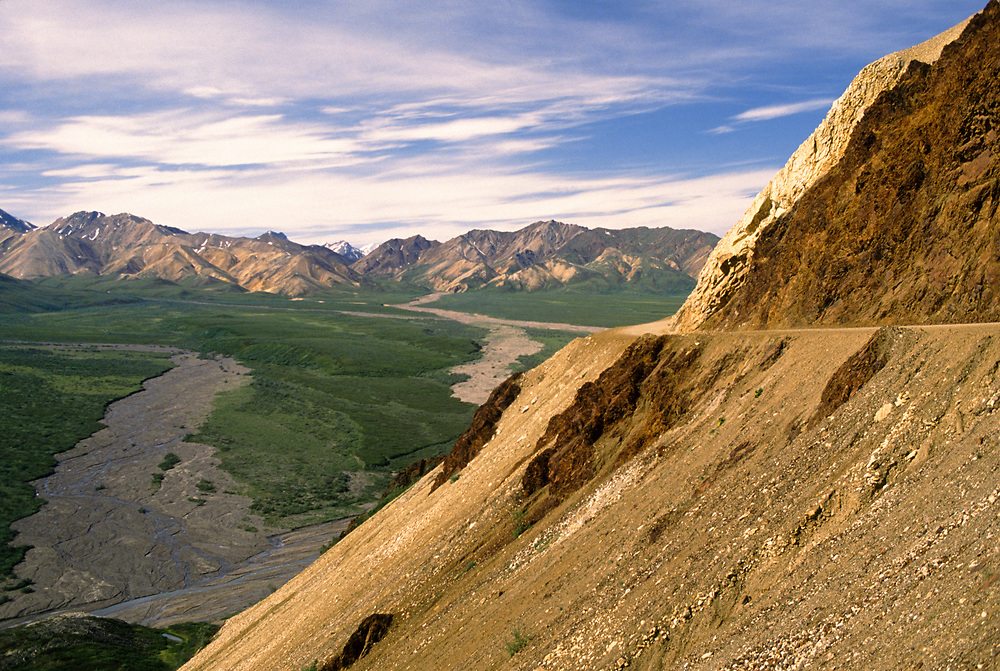 Alaska. Denali National Park, Polychrome Pass. A shuttle bus weaves along the park road high above the braided rivers of Polychrome Pass.