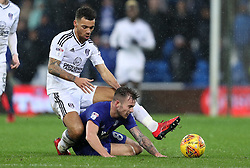 Cardiff City's Joe Ralls (right) and Fulham's Ryan Fredericks battle for the ball
