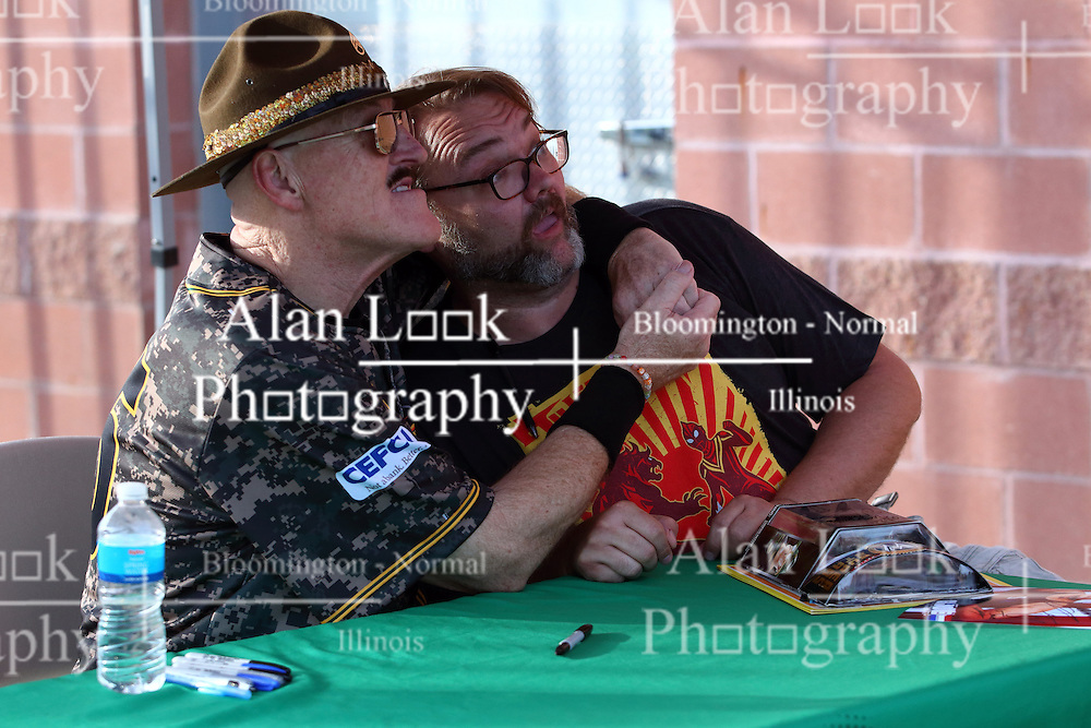 03 June 2016:  Sgt. Slaughter signs his autograph and poses for photos with fan Troy Babbs during a Frontier League Baseball game between the Windy City Thunderbolts and the Normal CornBelters at Corn Crib Stadium on the campus of Heartland Community College in Normal Illinois