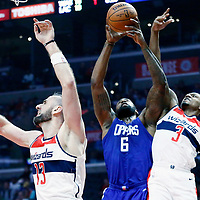 09 December 2017: LA Clippers center DeAndre Jordan (6) vies for the rebound with Washington Wizards guard Bradley Beal (3) and Washington Wizards center Marcin Gortat (13) during the LA Clippers 113-112 victory over the Washington Wizards, at the Staples Center, Los Angeles, California, USA.