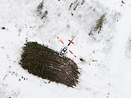 Grande Prairie, Alberta, .Photo by Randy Vanderveen.A helicopter flies trees out to a burn pile in an SRD mountain pine beetle control area in northwest Alberta.