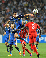 Nicolas Gaitan of Argentina, top, challenges Wisdom Fofo Agbo of Hong Kong during a friendly football match in Hong Kong, China, 14 October 2014.<br /> <br /> Lionel Messi needed just six minutes to make his mark in Argentina's 7-0 rout of Hong Kong in a friendly at Hong Kong Stadium on Tuesday (14 October 2014). The Barcelona star Messi scored twice after going on as a substitute for the last 30 minutes of the game to celebrate the 100th anniversary of the Hong Kong Football Association. Napoli striker Gonzalo Higuain and Benfica's Nicolas Gaitan also scored two goals each after Sevilla's Ever Banega had opened scoring in the 19th minute.