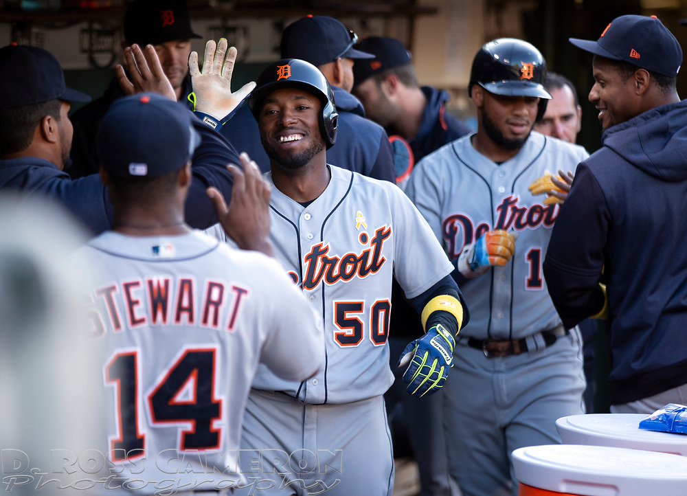 Sep 7, 2019; Oakland, CA, USA; Detroit Tigers Travis Demeritte (50) and Dawel Lugo are welcomed back to the dugout after scoring on a two-RBI single by Harold Castro during the second inning of a baseball game against the Oakland Athletics at Oakland Coliseum. Mandatory Credit: D. Ross Cameron-USA TODAY Sports