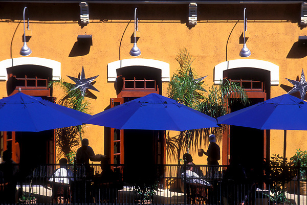 Stock photo of diners enjoying an outdoor patio at one of downtown Houston's restaurants.