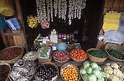 Vegetable stall in the market at Jakar, Bhutan. Hard cheese, a specialty of the area, hangs from strings above the fruits, vegetables and dried fish for sale. (Supporting image from the project Hungry Planet: What the World Eats.) Grocery stores, supermarkets, and hyper and megamarkets all have their roots in village market areas where farmers and vendors would converge once or twice a week to sell their produce and goods. In farming communities, just about everyone had something to trade or sell. Small markets are still the lifeblood of communities in the developing world.