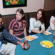 Devin DiMattia, left, Jordan Mullaney, second from left, Rachel Helms, and Holly Cole, far-right all members of Pineapple Shaped Lamps talk during the premiere party for Sketch 22, a show that airs on the Cape Fear CW. (Jason A. Frizzelle)