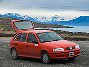 Visit Lake Argentina and Moreno Glacier in Los Glaciares National Park as a day trip from El Calafate, in southwest Santa Cruz province, in the southern Andes, Argentina. A red Volkswagon four door hatchback car rented for the day gave four of us flexibility to explore on our own schedule compared to a bus tour. The foot of South America is known as Patagonia, a name derived from coastal giants, Patagão or Patagoni, who were reported by Magellan's 1520s voyage circumnavigating the world and were actually Tehuelche native people who averaged 25 cm (or 10 inches) taller than the Spaniards.