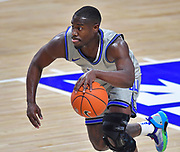 St Louis Billikens guard Fred Thatch Jr. (20) dribbles downcourt. St. Louis University hosted the University of Arkansas - Pine Bluff in a mens basketball game on December 5, 2020 at Chaifetz Arena on the SLU campus in St. Louis, MO.<br /> Photo by Tim Vizer