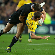 Quade Cooper, Australia, is tackled by Richard Kahui, New Zealand,  during the New Zealand V Australia Semi Final match at the IRB Rugby World Cup tournament, Eden Park, Auckland, New Zealand, 16th October 2011. Photo Tim Clayton...