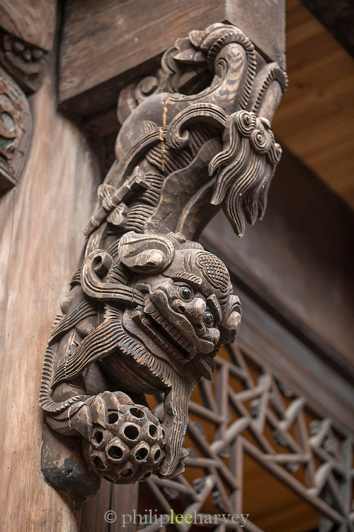 Architectural detail with close-up view of a carved wooden Chinese dragon, Old Town, Tunxi district, Huangshan City, Anhui Province, China