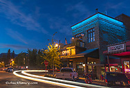 Caseys Bar along Central Avenue at dusk in downtown Whitefish, Montana, USA