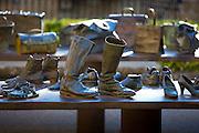 "Bronze table-top sculptures by Koko Rico titled ""Viajeros/Bidaiariak Izenekoa"" at Laguardia in Rioja-Alavesa area of Spain"