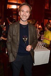 MARCUS WAREING at Models and Mothers Private View, a photographic exhibition in aid of Breakthrough Breast Cancer held at The Gilbert Scott, St Pancras Renaissance Hotel, London, NW1 on 7th October 2013.