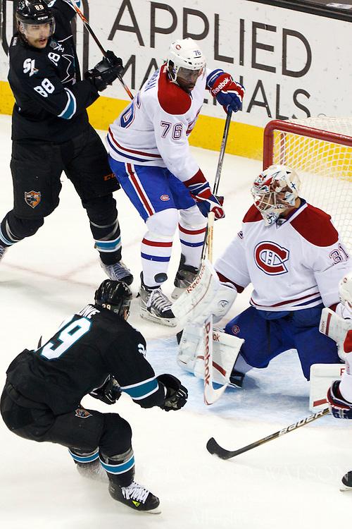 Dec 1, 2011; San Jose, CA, USA; San Jose Sharks left wing Ryane Clowe (29) scores a goal past Montreal Canadiens goalie Carey Price (31) during the third period at HP Pavilion.  San Jose defeated Montreal 4-3 in shootouts. Mandatory Credit: Jason O. Watson-US PRESSWIRE