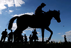 A view of a silhouetted horse and jockey during day three of Royal Ascot at Ascot Racecourse.