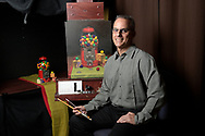Artist Jose Pardo poses in his home studio in Orlando, Fla., Monday, May 16, 2016. (Phelan M. Ebenhack via AP)