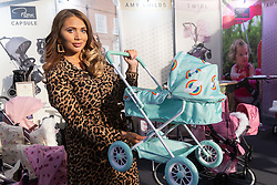 Reality TV star Amy Childs poses with her collection of prams which includes a 'unisex' set, pictured, at the Toy Fair at Kensington Olympia in London, the UK's largest dedicated game and hobby exhibition featuring the hottest and most anticipated products for the year ahead. London, January 22 2019.