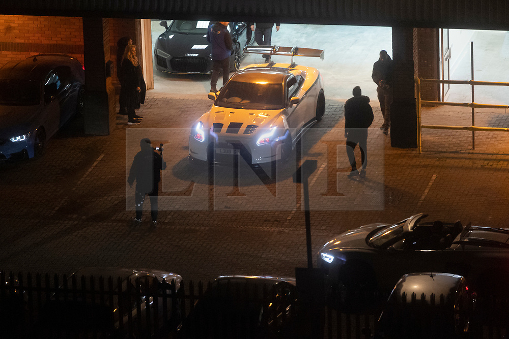 © Licensed to London News Pictures. 27/11/2020. London, UK. Car enthusiasts take part in a sports car rally meeting on an industrial estate in Alperton, North-West London during the second Covid-19 lockdown. Later, police officers arrived and disbursed the drivers. Photo credit: London News Pictures