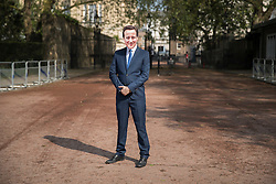 © Licensed to London News Pictures. 12/05/2016. London, UK. A protestor dressed as Prime Minister David Cameron gets ready to take part in a dance routine outside the anti-corruption summit. The real Mr Cameron is hosting a one day summit which is addressing world corruption. Photo credit: Peter Macdiarmid/LNP