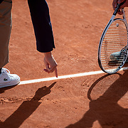 PARIS, FRANCE October 10.  The umpire points out where the ball touched the line to Dominic Stephan Stricker of Switzerland during his match against Leandro Riedi of Switzerland in the Boys' Singles Final on court fourteen during the French Open Tennis Tournament at Roland Garros on October 10th 2020 in Paris, France. (Photo by Tim Clayton/Corbis via Getty Images)
